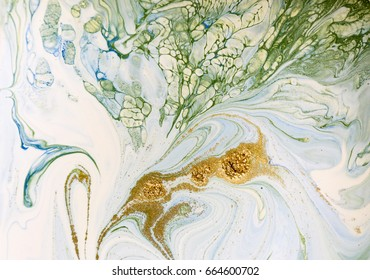 Marbled blue, green and gold abstract background. Liquid marble pattern.