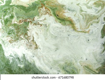 Marbled green and golden abstract background. Liquid marble pattern.