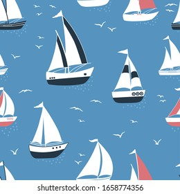 Marine seamless pattern with cartoon boats and silhouettes of birds on blue background