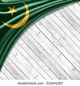 Mauritania  flag   of silk with copyspace for your text or images and wood background