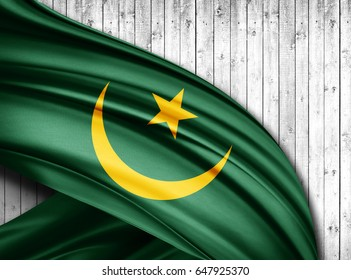 Mauritania flag of silk with copyspace for your text or images and wood  background -3D illustration