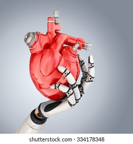 Mechanical heart in robots hand. Clipping path included