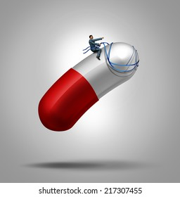 Medication control health care concept as a patient riding a capsule pill using a harness as a metaphor for controlling the dose in medical therapy or prescription drug abuse leading to addiction.