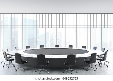 Meeting room interior with a large black round table, office chairs standing around it and a window with a magnificent view. 3d rendering mock up