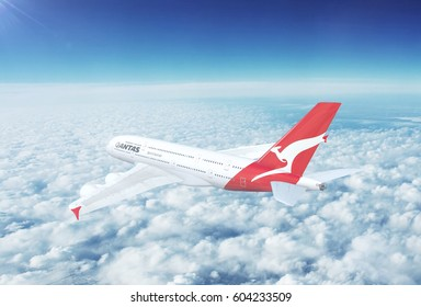 MELBOURNE, AUSTRALIA - CIRCA 2017: In-flight view of Qantas Airbus A380 Commercial Passenger Aircraft Flying High Up in the Sky Above the Clouds. 3D Illustration.