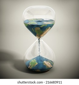Melting world concept with earth textured sand pouring inside the hourglass.  Image includes elements furnished by NASA.