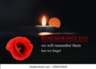 Memorial Day International Holocaust Remembrance Day The candle burns in memory of the dead Inscription REMEMBERANCE DAY and lest we forget and we will remember them next to a poppy flower and a  cand