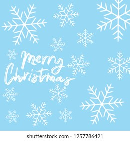 Merry Christmas Blue background with snowflakes around the text.