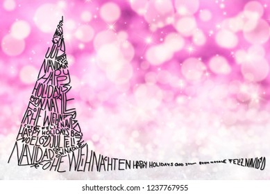 Merry Christmas In Different Languages Building Silhouette Of A Christmas Tree. Calligraphy And Illustration. Purple Glittering And Sparkling Background With Bokeh Effect. Copy Space For Advertisement