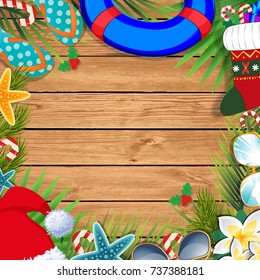Merry christmas and happy new year template on a warm climate design background. Summer vacation accessories and palm leaves together with santa hat, on wooden background.