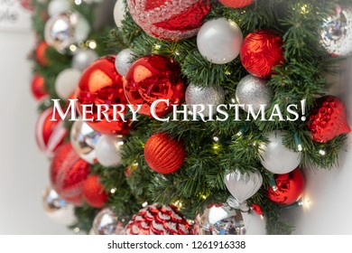 Merry Christmas Text with a Beautifully Decorated Wreath
