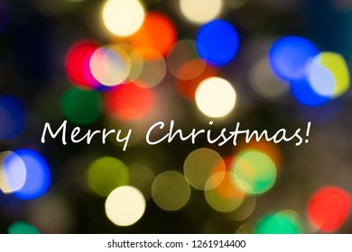 Merry Christmas Text on a Colorful Bokeh Background
