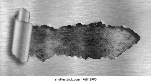 metal background ripped hole