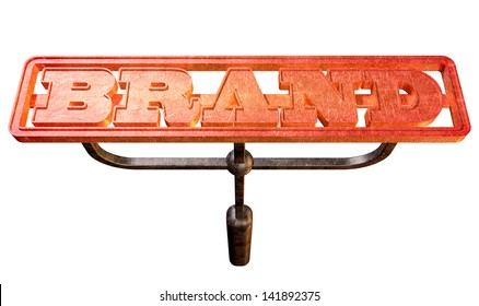 A metal cattle brand with the word brand as the marking area glowing red hot on an isolated background