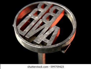 A metal cattle branding iron with the word brand as the marking area on an isolated dark surface - 3D render