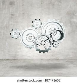 metal gears and cogwheels in room