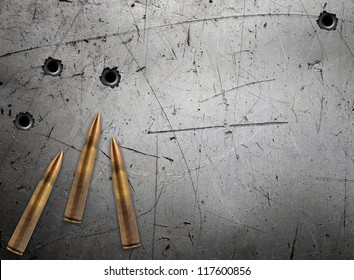 Metal plate with bullet holes