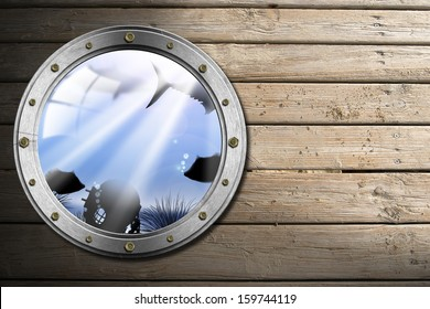 Metal Porthole with Sea Abyss Landscape / Metallic porthole with bolts and blue sea abyss landscape on wooden floor with sand