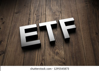 Metallic 3d ETF sign lying obliquely on wooden boards for an interesting header for Exchange Traded Funds with copy space. 3d Rendering