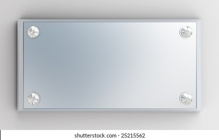 metallic tablet is bound screw-bolts on a white background