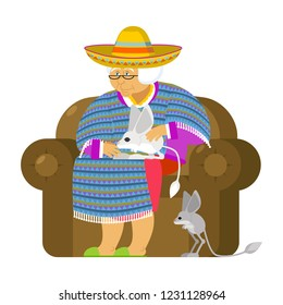 Mexican grandmother and Jerboa a pet. Old woman from Mexico on chair. Sombrero and poncho. Traditional clothes