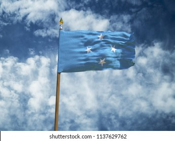 Micronesia flag Silk waving flag of Micronesia made transparent fabric with wooden flagpole gold spear on background sunny blue sky white smoke clouds real retro photo Countries world 3d illustration