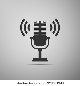 Microphone icon isolated on grey background. On air radio mic microphone. Speaker sign. Flat design