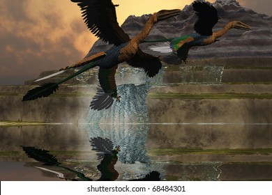 MICRORAPTOR - Two Microraptor dinosaurs fly near mountain waterfalls in prehistoric times.