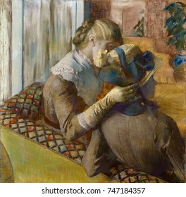 At the Milliners, by Edgar Degas, 1881, French impressionist drawing, pastel on paper. Two women customers, seen from behind, in a millinery shop