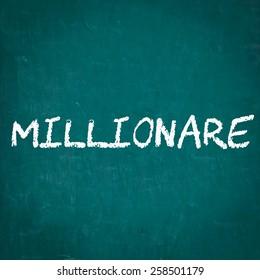 MILLIONARE written on chalkboard