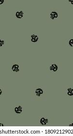 Mini skulls on khaki background