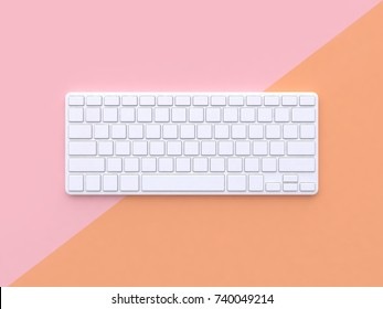 minimal abstract technology concept white keyboard pastel pink orange background tilted 3d rendering