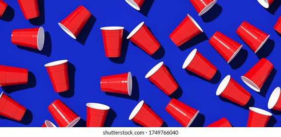 Minimal creative composition for beverage and party concept. Red plastic solo drinking cup on blue background. 3d rendering illustration. Object isolate clipping path included.