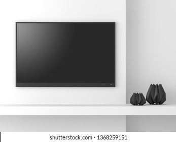Minimal style empty tv screen mockup 3d render,Hanging on white wall,decorate with black dimond shape vases,there is a clipping path to the tv screen.