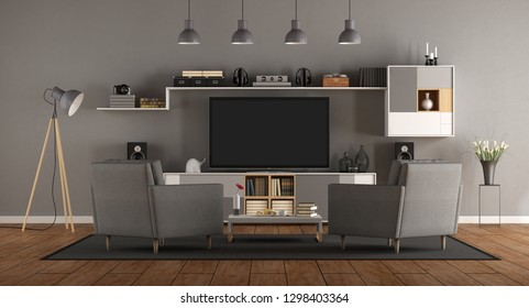 Minimalist gray room with home cinema system and two armchair -3d rendering