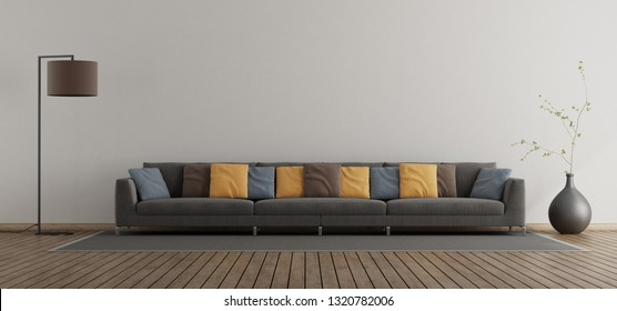 Minimalist living room with large sofa with colorful cushion - 3d rendering