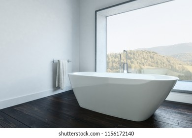 Minimalist White Walled Bathroom With Modern White Tub And Towel Holder.  Mountain Landscape Outside Window