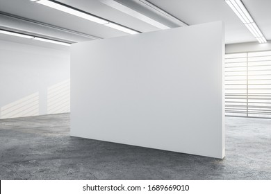 Minimalistic concrete gallery interior with city view, daylight and blank wall. Museum and art concept. Mock up, 3D Rendering