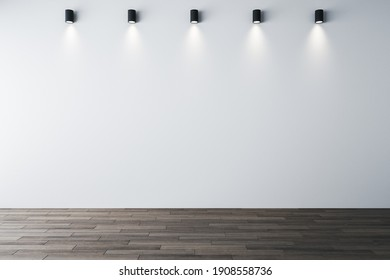Minimalistic gallery interior with ceiling lamps and blank white wall. Gallery and art concept. Mock up, 3D Rendering