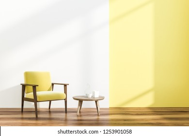 Minimalistic living room interior with white and yellow walls, wooden floor and yellow and wooden armchair near coffee table. 3d rendering