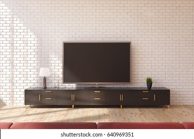 Minimalistic living room interior with a wooden closet standing near a white brick wall and a wide screen TV set on it. 3d rendering, mock up