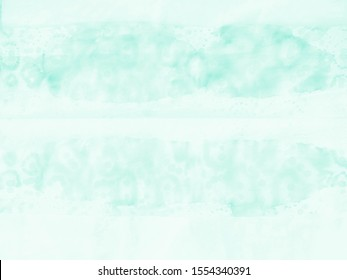 Mint Green Background. Textured Tie Dye backdrop. Shibori print. Tie Dye Art. Abstract bright backdrop. Green Shiny Fresh Day. Warm tones design. Tie Dye Freedom and happiness.