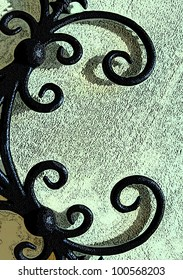 Mint green wall has curling ironwork.  The letter C is formed from curling elegant iron working.