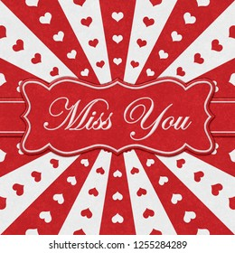Miss You message on a ribbon with red hearts with red and white burst lines 3D Illustration