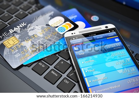 Mobile banking, financial success, accounting and electronic internet money payments business concept: macro view of stack of credit cards and modern touchscreen smartphone on office laptop keyboard