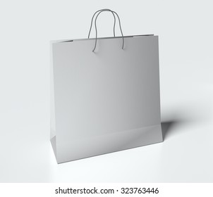 Mock up light gray paper bag with handles on white table.