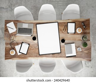 mock up poster frame on meeting conference table with office accessories and laptop computers, hipster interior background, 3D render