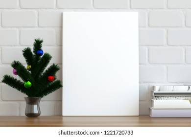 Mock up poster frame on the table with Christmas tree branches, 3D render