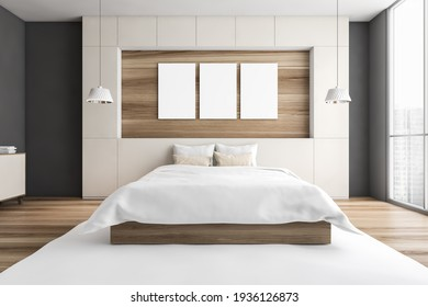 Mockup canvas three posters above bed with pillows, carpet and parquet floor. Wooden bedroom with city view, 3D rendering no people