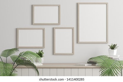 Mock-up of picture frame with small plant in vase and books on white wall. Perspective of modern Interior design. 3d rendering.
